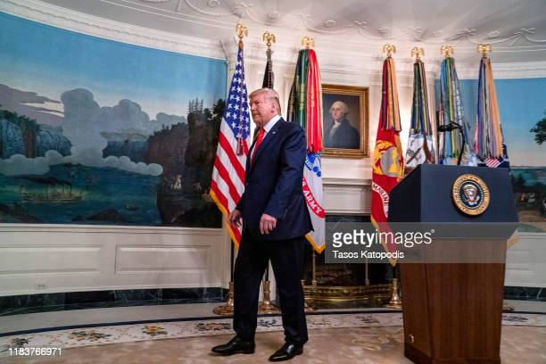 S President Donald Trump walks away after making a statement in the Diplomatic Reception Room of the White House October 27 2019 in Washington DC...
