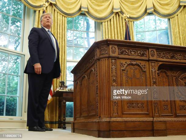 S President Donald Trump walks away after presenting the Medal of Freedom to retired Boston Celtic Bob Cousy in the Oval Office at the White House on...