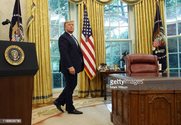 President Donald Trump walks away after presenting the Medal of Freedom to retired Boston Celtic Bob Cousy in the Oval Office at the White House on...