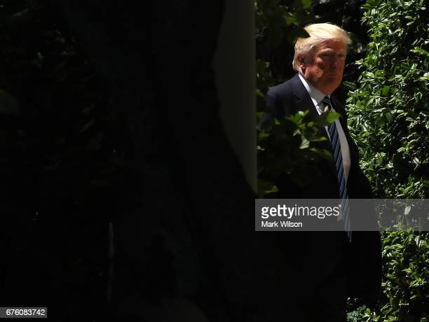 S President Donald Trump walks away after presenting the US Air Force Falcons football team with the CommanderinChief trophy in the Rose Garden at...