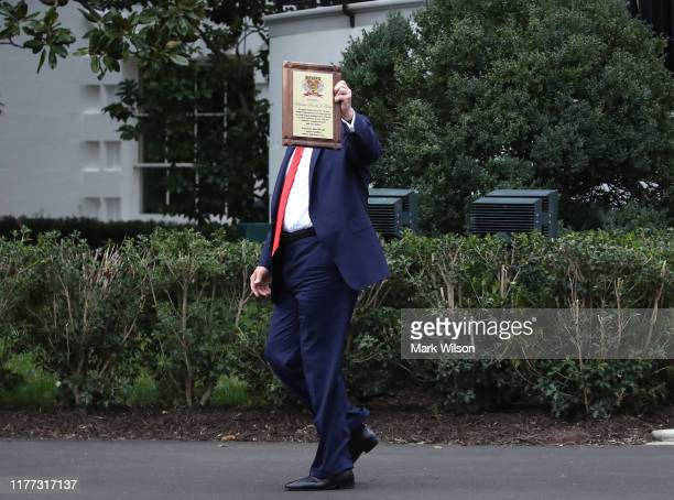 S President Donald Trump walks away after receiving an award from the National Sheriffs' Association at the White House on September 26 2019 in...