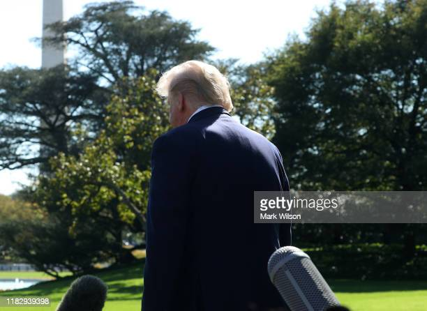 S President Donald Trump walks away after speaking to the media while departing on Marine One for Pittsburgh to speak at the annual Shale Insight...