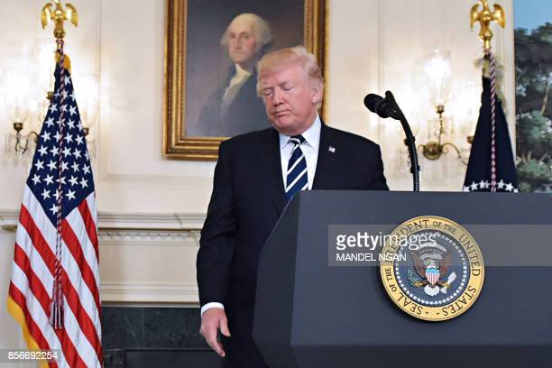 President Donald Trump walks away from the podium after delivering a statement on the Las Vegas shooting from the Diplomatic Reception Room of the...