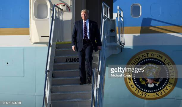 S President Donald Trump walks down the stairs after arriving on Air Force One at LAX Airport on February 18 2020 in Los Angeles California