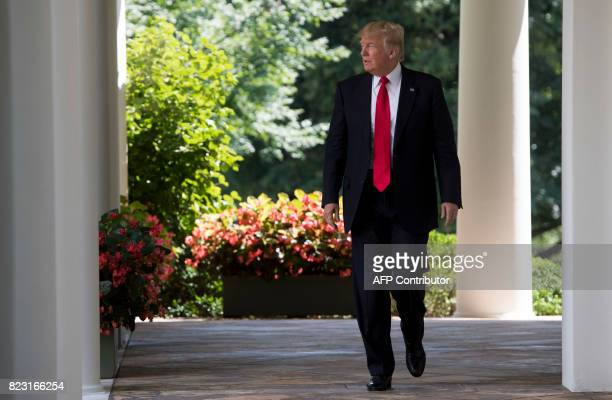 US President Donald Trump walks down the West Wing Colonnade to speak to the American Legion Boys Nation and the American Legion Auxiliary Girls...
