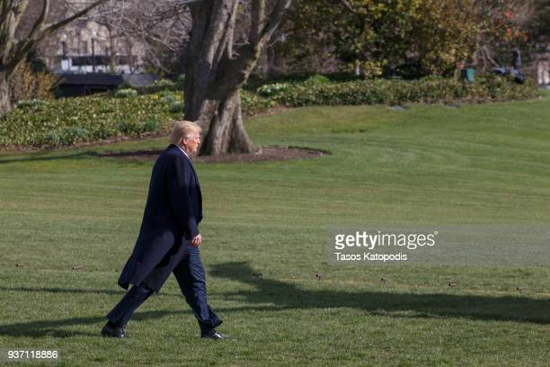 S President Donald Trump walks from greeting visitors to the Marine One helicopter as he departs for MarALago from the South Lawn of the White House...