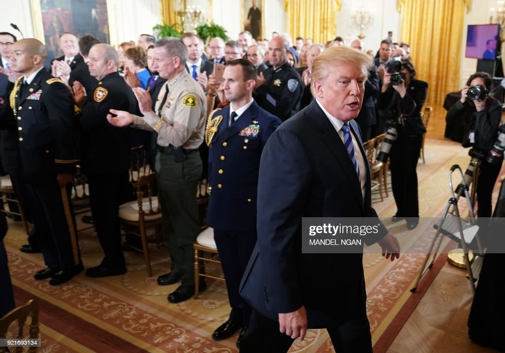 US President Donald Trump walks from the East Room after attending the Public Safety Medal of Valor Awards Ceremony at the White House on February 20, 2018 in Washington, DC. /
