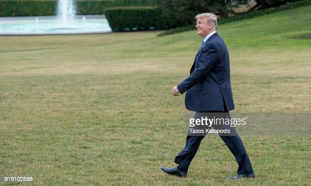 President Donald Trump walks from the Oval Office to the Marine One helicopter as they depart from the South Lawn of the White House on February 16...