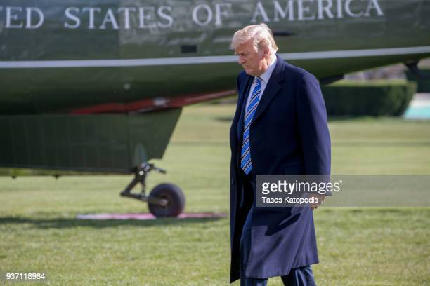 S President Donald Trump walks from the Oval Office to the Marine One helicopter as he departs for MarALago from the South Lawn of the White House on...
