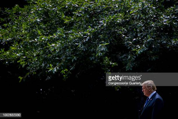 President Donald Trump walks from the West Wing to Marine One on his way to Joint Base Andrews Friday July 20 2018