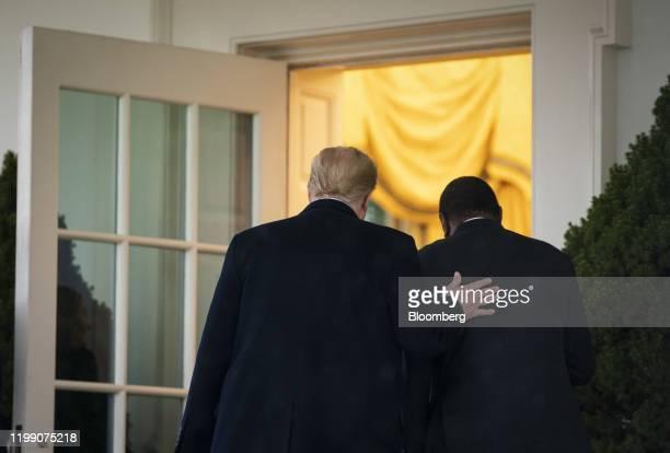 US President Donald Trump walks in the Oval Office with Uhuru Kenyatta Kenya's president right in Washington DC US on Thursday Feb 6 2020 Trumpis...
