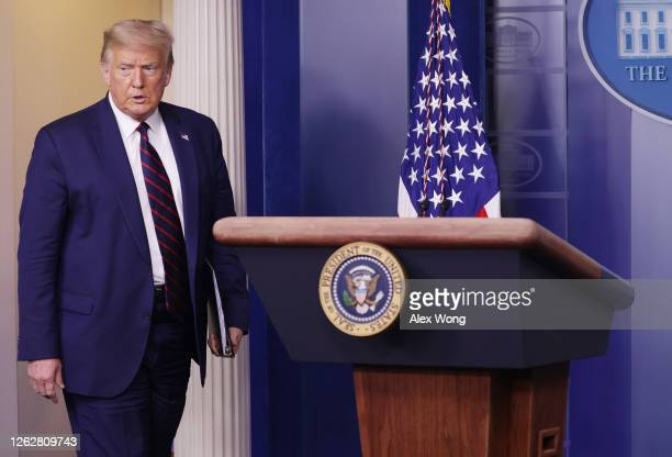 President Donald Trump walks into his news conference in the James Brady Briefing Room of the White House July 30, 2020 in Washington, DC. Earlier in...