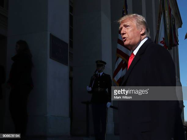 S President Donald Trump walks into the Pentagon for a meeting with military leaders on January 18 2018 in Arlington Virginia
