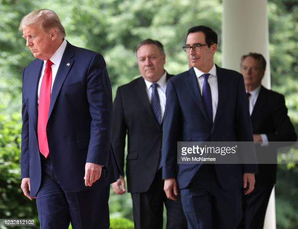 S President Donald Trump walks into the Rose Garden to make a statement about US relations with China at the White House May 29 2020 in Washington DC...