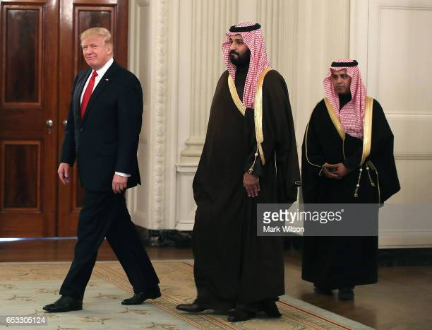 S President Donald Trump walks into the State Dinning Room to have lunch with Mohammed bin Salman Deputy Crown Prince and Minister of Defense of the...