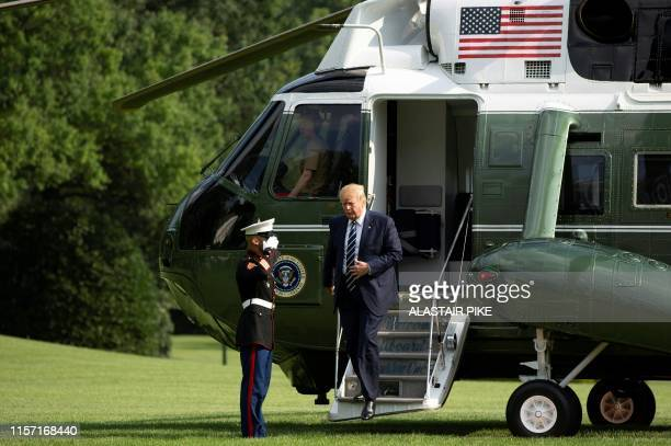 US President Donald Trump walks off Marine One as he returns to the White House on July 21 2019 in Washington DC Trump is returning to Washington...