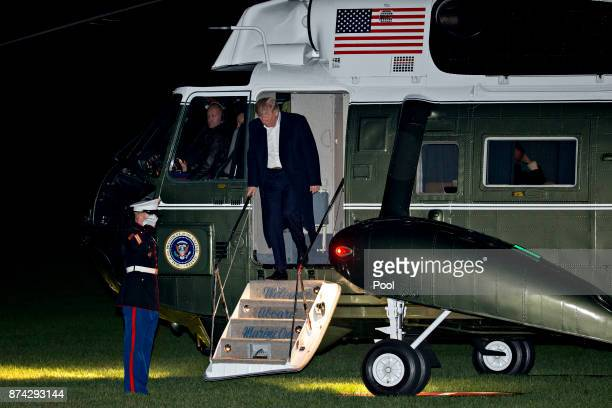 S President Donald Trump walks off Marine One on the South Lawn of the White House after returning from an 11day Asia trip November 14 2017 in...