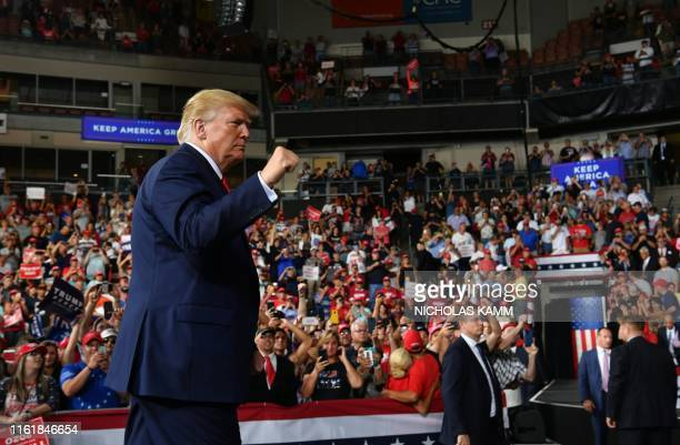 US President Donald Trump walks off stage after a Keep America Great campaign rally at the SNHU Arena in Manchester New Hampshire on August 15 2019