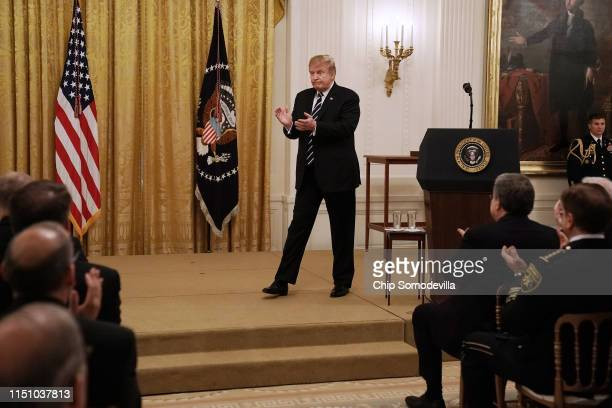S President Donald Trump walks off the podium after presenting the Public Safety Officer Medal of Valor to more than a dozen people during a ceremony...