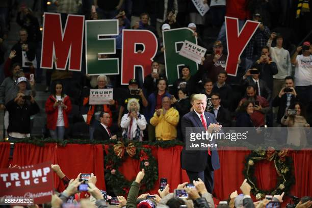 S President Donald Trump walks on stage as he holds a rally at the Pensacola Bay Center on December 8 2017 in Pensacola Florida Mr Trump was expected...