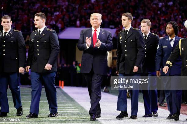 S President Donald Trump walks on the field prior to the CFP National Championship presented by ATT between the Georgia Bulldogs and the Alabama...