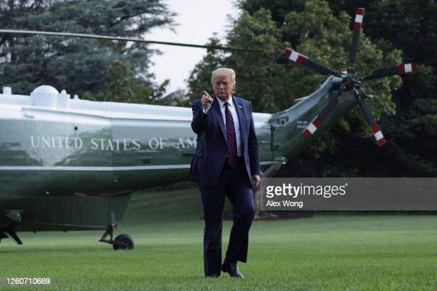 President Donald Trump walks on the South Lawn after he landing aboard Marine One at the White House July 27, 2020 in Washington, DC. Trump was...