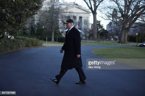 S President Donald Trump walks on the South Lawn after he returned to the White House March 2 2017 in Washington DC President Trump has returned from...