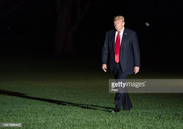 US President Donald Trump walks on the South Lawn of the White House October 10 2018 in Washington DC The president was returning from a rally in...