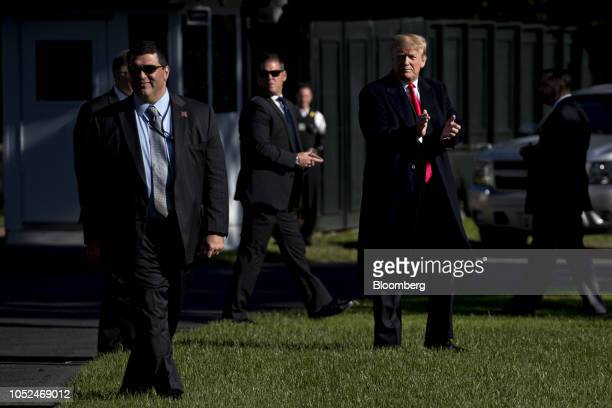 US President Donald Trump walks on the South Lawn of the White House before boarding Marine One in Washington DC US on Thursday Oct 18 2018 Trump is...