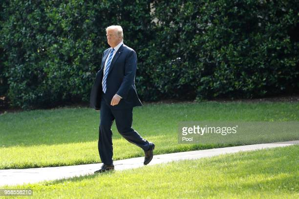 S President Donald Trump walks on the South Lawn of the White House before his departure to Walter Reed Medical Center on May 14 2018 in Washington...