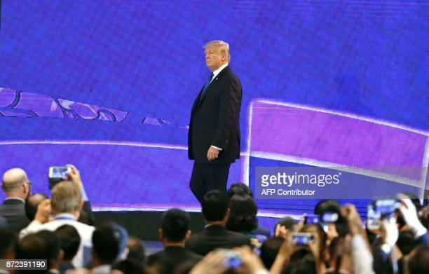 US President Donald Trump walks on the stage as he speaks on the final day of the APEC CEO Summit part of the broader AsiaPacific Economic...