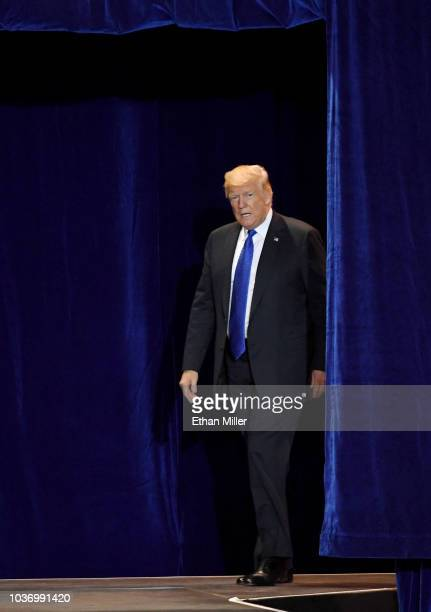 S President Donald Trump walks onstage for a campaign rally at the Las Vegas Convention Center on September 20 2018 in Las Vegas Nevada Trump is in...
