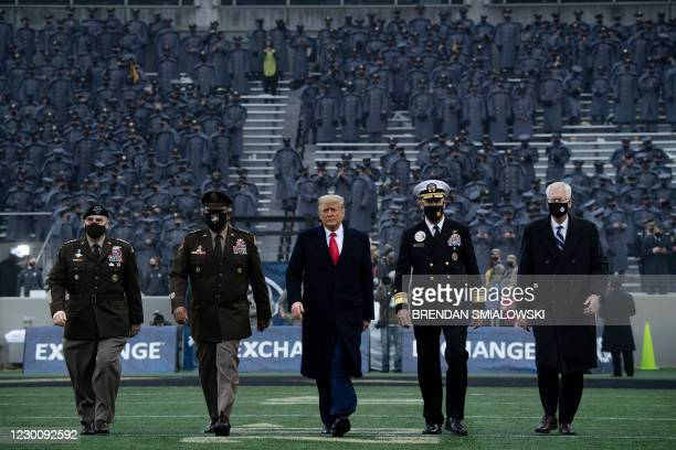President Donald Trump walks onto the field before the start of the Army-Navy football game at Michie Stadium on December 12, 2020 in West Point, New...