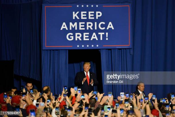 """President Donald Trump walks onto the stage during a """"Keep America Great"""" campaign rally at BancorpSouth Arena on November 1, 2019 in Tupelo,..."""