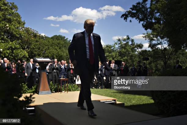 US President Donald Trump walks out after an announcement in the Rose Garden of the White House in Washington DC US on Thursday June 1 2017 Trump...