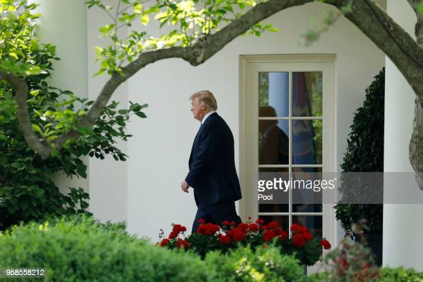 S President Donald Trump walks out from the Oval Office of the White House before his departure to Walter Reed Medical Center on May 14 2018 in...