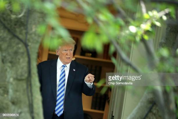 S President Donald Trump walks out of the Oval Office as he departs the White House June 1 2018 in Washington DC Trump is traveling to Camp David