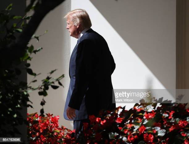 President Donald Trump walks out of the Oval Office before departing on Marine One at the White House on September 27 2017 in Washington DC President...