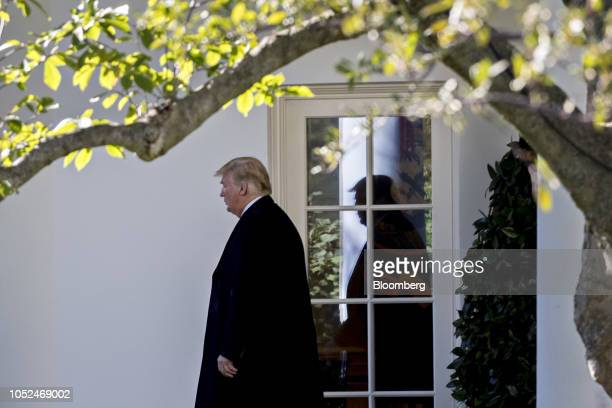 US President Donald Trump walks out of the Oval Office of the White House before boarding Marine One in Washington DC US on Thursday Oct 18 2018...
