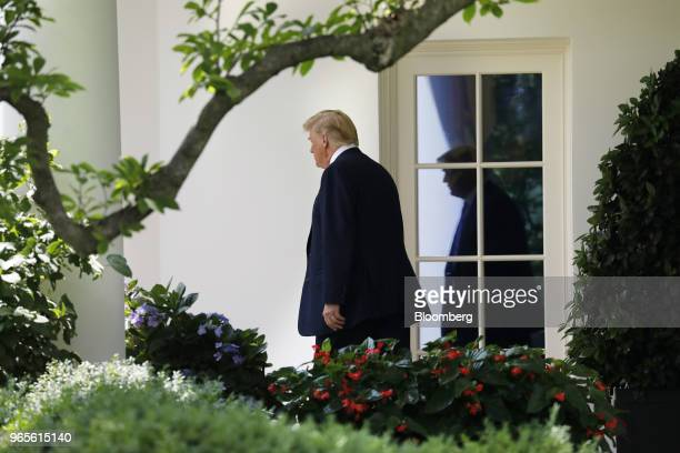 US President Donald Trump walks out of the Oval Office of the White House to board Marine One before departing to Camp David in Washington DC US on...