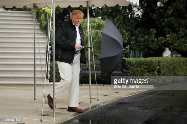 S President Donald Trump walks out of the White House before boarding Marine One and departing October 15 2018 in Washington DC The President and...