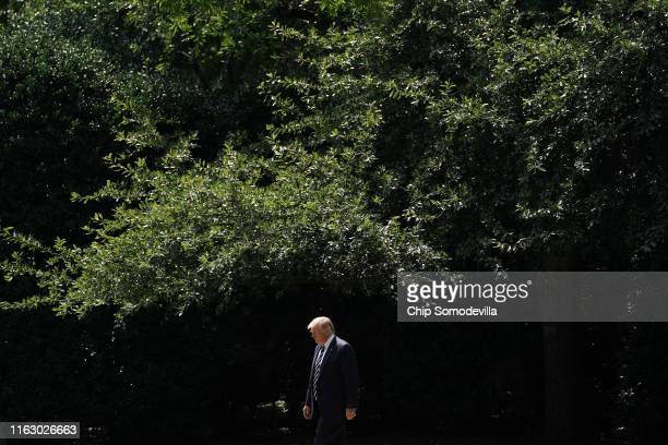 S President Donald Trump walks out of the White House before departing July 19 2019 in Washington DC Trump is traveling to New Jersey to host a...