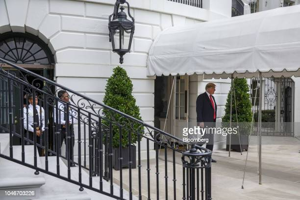 US President Donald Trump walks out to speak to members of the media before boarding Marine One on the South Lawn of the White House in Washington DC...