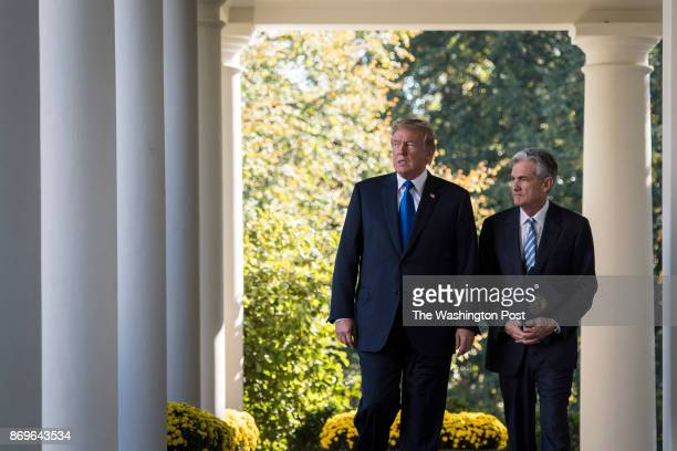 President Donald Trump walks out with Federal Reserve board member Jerome Powell to announce him as his nominee for the next chair of the Federal...