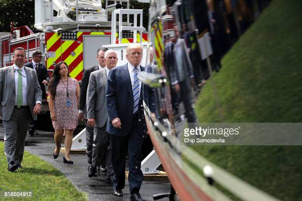 S President Donald Trump walks past a boat made by Hinckley Yachts while touring a Made in America product showcase on the South Lawn of the White...