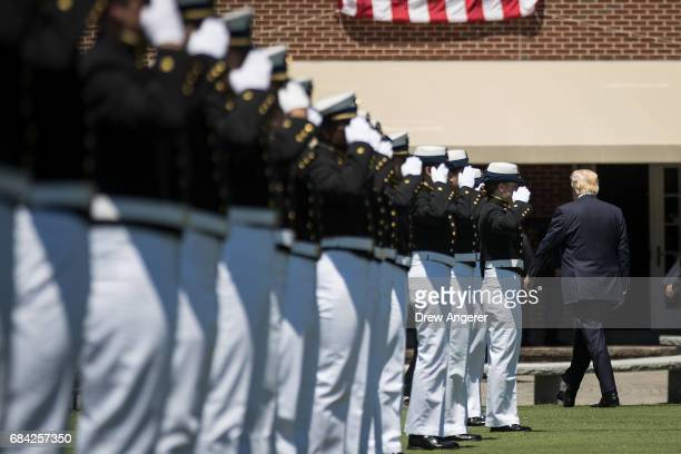 President Donald Trump walks past members of the US Coast Guard as he exits the commencement ceremony for the US Coast Guard Academy May 17 2017 in...