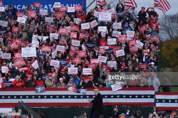President Donald Trump walks past supporters during a campaign event on October 24, 2020 in Circleville, Ohio. President Trump continues to campaign...