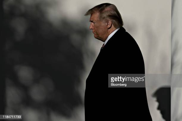 President Donald Trump walks through the Colonnade of the White House with Boyko Borissov, Bulgaria's prime minister, not pictured, in Washington,...