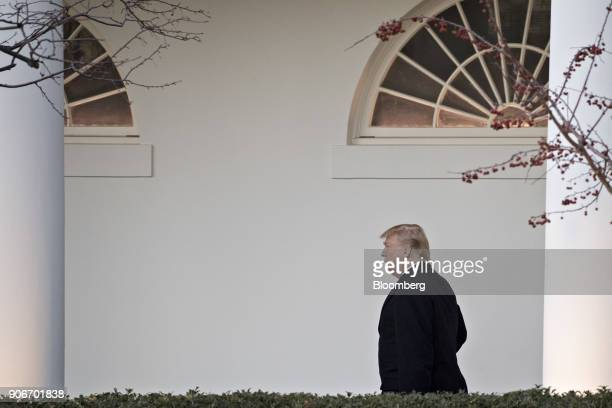 US President Donald Trump walks through the Colonnade of the White House in Washington DC US on Thursday Jan 18 2018 Trump today threw a wrench into...
