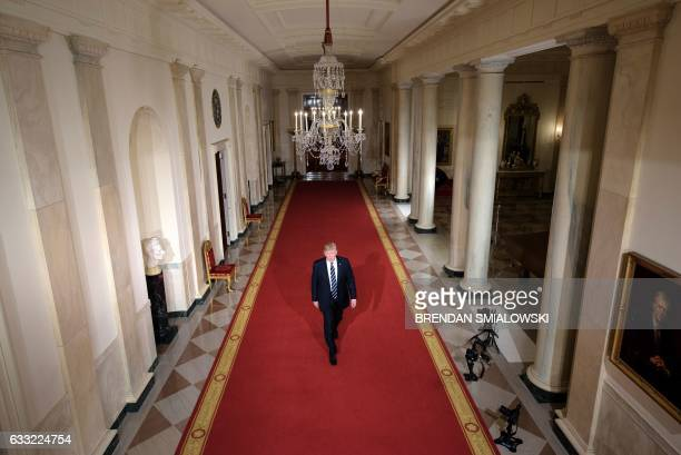 President Donald Trump walks through the Cross Hall to the East Room to nominate Neil M Gorsuch to take Justice Antonin Scalia's vacancy on the US...